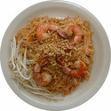 Pud Thai - <div><em>Thin rice noodles with bean sprouts, egg, vegetables, hot chili, stir-fried in a spicy, sweet sauce &amp; topped with ground peanuts</em></div>